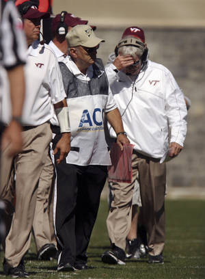 Photo -   Virginia Tech head coach Frank Beamer, right, reacts as his team falls behind by twenty points in the first quarter of an NCAA college football game against Duke in Blacksburg Va, Saturday Oct. 13 2012. (AP Photo / the Roanoke Times, Matt Gentry) LOCAL TV OUT; SALEM TIMES REGISTER OUT; FINCASTLE HERALD OUT; CHRISTIANBURG NEWS MESSENGER OUT; RADFORD NEWS JOURNAL OUT; ROANOKE STAR SENTINEL OUT