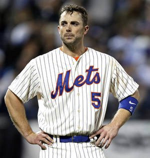 Photo - New York Mets' David Wright stands after grounding out in the eighth inning with a runner in scoring position in a baseball game against the New York Yankees in New York, Thursday, May 15, 2014. (AP Photo/Kathy Willens)