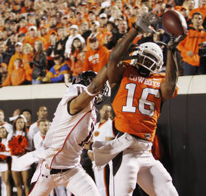 Photo - Cowboy Perrish Cox (16) breaks up a pass in the end zone intended for Tramain Swindall (11) during the college football game between Oklahoma State University (OSU) and Texas Tech University (TTU) at Boone Pickens Stadium in Stillwater, Okla. Photo by Doug Hoke, The Oklahoman