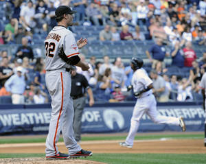 Photo - San Francisco Giants pitcher Ryan Voglesong, left, reacts as New York Yankees' Eduardo Nunez rounds the bases after hitting a two-run home run during the fourth inning of an interleague baseball game  Saturday, Sept. 21, 2013, at Yankee Stadium in New York. (AP Photo/Bill Kostroun)
