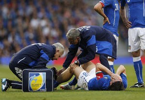 Photo - Italy's Riccardo Montolivo, lower right, is being treated after injured from a tackle during their international friendly soccer match against the Republic of Ireland, at Craven Cottage, London, Saturday, May 31, 2014. (AP Photo/Sang Tan)