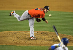 Photo - Miami Marlins starting pitcher Tom Koehler pitches to Los Angeles Dodgers' Yasiel Puig during the third inning of a baseball game, Monday, May 12, 2014, in Los Angeles. (AP Photo)