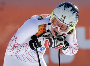 Photo - United States' Jacqueline Wiles rests after a women's downhill training run for the Sochi 2014 Winter Olympics, Saturday, Feb. 8, 2014, in Krasnaya Polyana, Russia. (AP Photo/Gero Breloer)