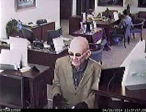 Photo -  A man in a mask robs the IBC bank branch in Moore on Saturday. Photo provided  <strong>   -   </strong>