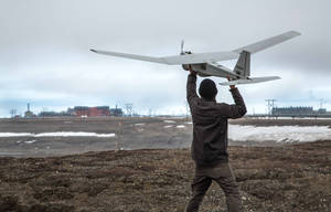Photo - In this photo June 7, 2014, photo released by BP Alaska, Unmanned Aerial System (UAS) technology using an AeroVironment Puma drone is given a pre-flight checkout in preparation for flights by BP at its Prudhoe Bay, Alaska operations. The Federal Aviation Administration granted the first permission for commercial drone flights over land, the latest effort by the agency to show it is loosening restrictions on commercial uses of the unmanned aircraft.  The federal effort to provide drones regular access to U.S. skies faces significant hurdles and won't meet a September 2015 deadline set by Congress, said a report released June 30 by a government watchdog. A report by the Transportation Department's inspector general says the Federal Aviation Administration hasn't figured out what kind of technology unmanned aircraft should use to avoid crashing into other planes. (AP Photo/BP Alaska)