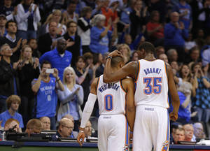Photo - OKC's Russell Westbrook, left, and Kevin Durant walk off the court after a time out during Thursday night's 107-95 win over the Bulls.  Photo by Bryan Terry, The Oklahoman