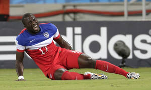 Photo - United States' Jozy Altidore grimaces after pulling up injured during the group G World Cup soccer match between Ghana and the United States at the Arena das Dunas in Natal, Brazil, Monday, June 16, 2014.  (AP Photo/Dolores Ochoa)