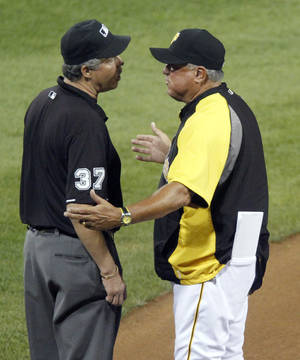Photo -   Pittsburgh Pirates manager Clint Hurdle, right, argues with third base umpire Gary Darling after Darling called Chicago Cubs' Brett Jackson safe in the sixth inning of a baseball game Friday, Sept. 7, 2012, in Pittsburgh. Hurdle was ejected from the game. (AP Photo/Keith Srakocic)