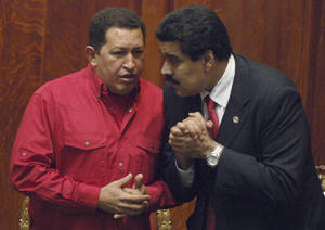 Photo -   FILE - In this Dec. 18, 2007 file photo Venezuela's President Hugo Chavez, left, talks to his Foreign Minister Nicolas Maduro at the University of Uruguay in Montevideo, Uruguay. President Hugo Chavez on Wednesday, Oct. 10, 2012, named Nicolas Maduro as his new vice president. Maduro, a former National Assembly member, has headed the foreign ministry since 2006, and is seen as one of the administration's hard-liners. (AP Photo/Matilde Campodonico, File)