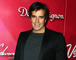 """Photo - FILE - In this Feb. 18, 2012 file photo, Illusionist David Copperfield arrives at the Keep Memory Alive 16th Annual """"Power of Love Gala"""" honoring Muhammad Ali with his 70th birthday celebration, in Las Vegas. Attorneys for  Copperfield and several current and former Las Vegas stagehands say they're talking about settling a pair of lawsuits filed in a dispute about trade secrets and overtime pay. A Feb. 15, 2014 federal lawsuit accuses Copperfield of sometimes making stagehands work 14 hours a day and seven days a week. (AP Photo/Jeff Bottari, file)"""