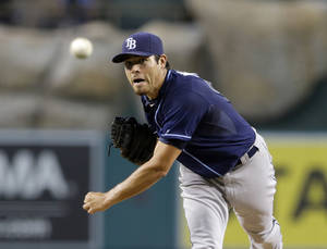 Photo - Tampa Bay Rays starter Matt Moore pitches to the Los Angeles Angels in the first inning of a baseball game in Anaheim, Calif., Tuesday, Sept. 3, 2013.  (AP Photo/Reed Saxon)