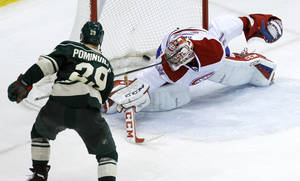 Photo - Minnesota Wild right wing Jason Pominville (29) scores the game-winning goal past Montreal Canadiens goalie Carey Price (31) during the third period of an NHL hockey game in St. Paul, Minn., Friday, Nov. 1, 2013. The Wild beat the Canadiens 4-3. (AP Photo/Ann Heisenfelt)