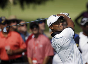 Photo - Tiger Woods hits from from the second tee during the second round of the Tour Championship golf tournament at East Lake Golf Club in Atlanta, Friday, Sept. 20, 2013. (AP Photo/John Bazemore)