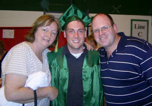 "Photo -   This June 2007 family photo provided by the Weiler/Meyers family shows, Greg Weiler, center with his legal guardians, aunt Joanne Meyers, and uncle Chris Meyers at his high school graduation from Elk Grove High School, in Elk Grove Village, Ill. Wieler who has a a long history of mental illness has been charged with plotting to attack dozens of churches in Oklahoma with home made Molotov cocktails. Weiler's parents both committed suicide, and Weiler has battled drug addiction and ""a lot of mental illnesses"" that led to a suicide attempt in the eighth grade, said his cousin Johnny Meyers. Meyers' parents served as legal guardians for Weiler after the death of his parents. He said family members in suburban Chicago believe Weiler must have stopped taking his medication and planned to go to Oklahoma to see him. (AP Photo/courtesy the Weiler/Meyers family)"