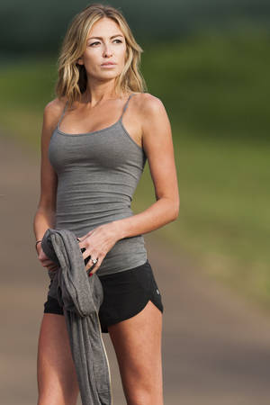 """Photo - FILE - In this Friday, Jan. 3, 2014, file photo, Paulina Gretzky stands near the 18th fairway during the first round of the Tournament of Champions golf tournament, in Kapalua, Hawaii. LPGA Tour Commissioner Mike Whan weighed in Friday, April 4, 2014, on Golf Digest's provocative cover featuring Gretzky. """"Obviously, we're disappointed and frustrated by the editorial direction (and timing) Golf Digest has chosen with the announcement of its most recent magazine cover,"""" Whan said in a statement at the Kraft Nabisco Championship, the tour's first major tournament of the year. The cover photo shows Gretzky in skintight capris and a bra. (AP Photo/Marco Garcia, File)"""