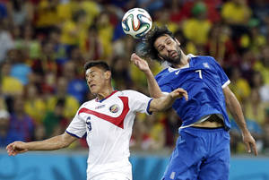 Photo - Costa Rica's Celso Borges, left, and Greece's Giorgos Samaras battle for the ball during the World Cup round of 16 soccer match between Costa Rica and Greece at the Arena Pernambuco in Recife, Brazil, Sunday, June 29, 2014. (AP Photo/Ricardo Mazalan)