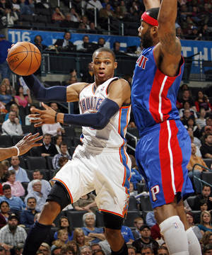 photo - Russell Westbrook (0) of Oklahoma City passes the ball away from Detroit's Chris Wilcox (9) during an NBA basketball game between the Oklahoma  City Thunder and the Detroit Pistons at the OKC Arena in Oklahoma City, Friday, March 11, 2011. Photo by Nate Billings, The Oklahoman