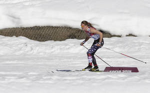 Photo - Sophie Caldwell of the United States skis with a sleeveless top as temperatures go well over the freezing point during the women's 10K classical-style cross-country race at the 2014 Winter Olympics, Thursday, Feb. 13, 2014, in Krasnaya Polyana, Russia. (AP Photo/Matthias Schrader)