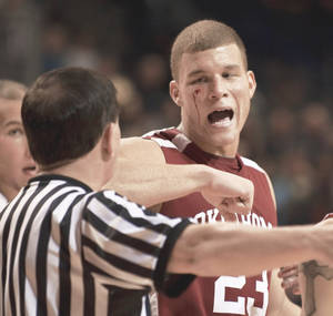 Photo - OU's Blake Griffin was bloodied by an elbowed to the face on Monday night against Rice in Houston. AP photo