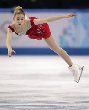 Photo - Gracie Gold of the United States competes in the women's short program figure skating competition at the Iceberg Skating Palace during the 2014 Winter Olympics, Wednesday, Feb. 19, 2014, in Sochi, Russia. (AP Photo/Bernat Armangue)
