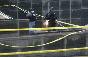 photo - Heavily armed police enter the   New Castle County Courthouse, Monday morning, Feb. 11, 2013 in Wilmington, Del.  The mayor of Wilmington, Del., says a man suspected of killing his wife and wounding two others at the New Castle County Courthouse has been killed by police.  (AP Photo/The News Journal/William Bretzger)  PHILADELPHIA TV OUT AND PHILADELPHIA ONLINE SITES OUT