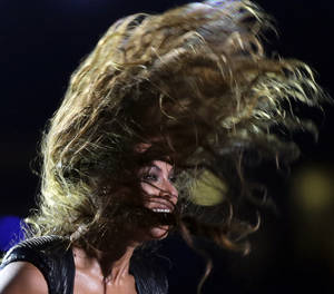 Photo - Beyonce performs during the halftime show of  the NFL Super Bowl XLVII football game between the San Francisco 49ers and the Baltimore Ravens, Sunday, Feb. 3, 2013, in New Orleans. (AP Photo/Matt Slocum)