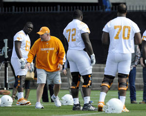 Photo - In this photo taken on March 9, 2013, Tennessee offensive line coach Don Mahoney, second fromleft, instructs players Marques Pair, from left, Zach Fulton, Ja'Wuan James and James Stone during spring NCAA college football practice in Knoxville, Tenn. (AP Photo/Knoxville News Sentinel, Amy Smotherman Burgess)