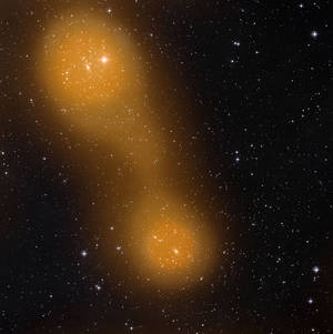 Photo - This image released on Thursday March 21, 2013 by the European Space Agency (ESA)  from the Planck spacecraft shows a bridge of hot gas that connects galaxy clusters about a billion light-years from Earth. (AP Photo/ESA Planck Collaboration)