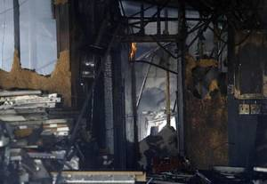 photo - Fire destroyed a grocery store building on Thursday, Feb. 14, 2013 in Tuttle, Okla. Photo by Steve Sisney