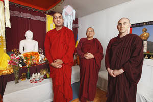 Photo - Buddhist monks Rev. Hingulwala Piyaratana, who goes by his Buddhist title Bhante Ratana, Rev. Ananda and Rev. Santikaro next to the alter in their Buddhist home in Oklahoma City Monday, Sept. 16, 2013. Photo by Paul B. Southerland, The Oklahoman