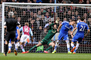 Photo - Aston Villa's  Fabian Delph, second left, scores against Chelsea during the English Premier League soccer match between Aston Villa and Chelsea at Villa Park, Birmingham, England, Saturday, March 15, 2014.  (AP Photo/Rui Vieira)