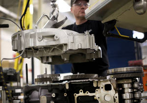 Photo - In this March 26, 2014 photo, Jerry Drury works on a truck engine assembly line at Volvo Trucks' powertrain manufacturing facility in Hagerstown, Md. The Institute for Supply Management, a trade group of purchasing managers, issues its index of manufacturing activity for May on Tuesday, July 1, 2014. (AP Photo/Patrick Semansky)