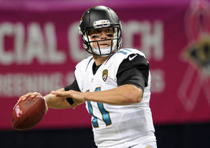 Photo - Jacksonville Jaguars quarterback Blaine Gabbert throws during the first quarter of an NFL football game against the St. Louis Rams Sunday, Oct. 6, 2013, in St. Louis. (AP Photo/L.G. Patterson)