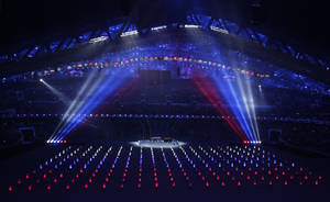 Photo - Performers wearing illuminated suits create the Russian flag during the opening ceremony of the 2014 Winter Olympics in Sochi, Russia, Friday, Feb. 7, 2014. (AP Photo/Robert F. Bukaty)