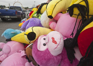 Photo -   Toy plush animals sit on the midway at the Arkansas State Fairgrounds in Little Rock, Ark., Thursday, Oct. 11, 2012. The fair is scheduled to open Friday, Oct. 12, and run through Oct. 21. (AP Photo/Danny Johnston)