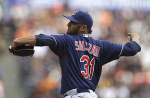 Photo - Cleveland Indians' Danny Salazar works against the San Francisco Giants in the first inning of a baseball game, Sunday, April 27, 2014, in San Francisco. (AP Photo/Ben Margot)