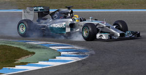 Photo - Mercedes driver Lewis Hamilton of Great Britain drives his Mercedes W05 Formula One car at the Circuito de Jerez on Tuesday, Jan. 28, 2014, in Jerez de la Frontera, Spain. (AP Photo/Miguel Angel Morenatti)