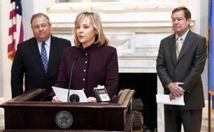 Photo - Oklahoma Governor-elect Mary Fallin announces Glenn Coffee (left) and Larry Nichols as her transition team leaders, during a press conference in the Blue Room of the State Capitol in Oklahoma City, OK, Monday, Nov. 8, 2010. By Paul Hellstern, The Oklahoman ORG XMIT: KOD