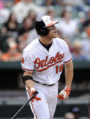 Photo - Baltimore Orioles' Chris Davis watches his two-run home run during the eighth inning of a baseball game against the Colorado Rockies, Sunday, Aug. 18, 2013, in Baltimore. The Orioles won 7-2. (AP Photo/Nick Wass)