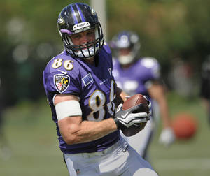 Photo - Baltimore Ravens wide receiver Billy Bajema runs a drill during NFL football training camp at the team's practice facility in Owings Mills, Md., Monday, July 29, 2013. (AP Photo/Gail Burton) ORG XMIT: OTKS110