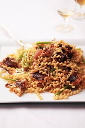 Photo - Fusilli Bucati with Soft-Shell Crabs and Hot Chiles. <strong>Quentin Bacon - MCT</strong>