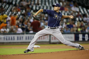 Photo - Tampa Bay Rays' Matt Moore delivers a pitch against the Houston Astros in the first inning of a baseball game, Monday, July 1, 2013, in Houston. (AP Photo/Pat Sullivan)