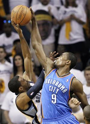 Photo - Forward Serge Ibaka, right, will start Monday's game for Oklahoma City.  AP PHOTO