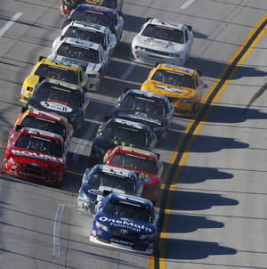 Photo - Elliott Sadler (11) leads a pack of cars during the NASCAR Aaron's 312 Nationwide series auto race at Talladega Superspeedway, Saturday, May 3, 2014, in Talladega, Ala. (AP Photo/John Bazemore)