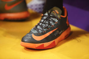 """Photo - FILE - In this Sunday, March 9, 2014, file photo, Nike KD VI """"Team Orange"""" shoes worn by Oklahoma City Thunder small forward Kevin Durant are photographed in Los Angeles. Nike reports quarterly financial results after the market closes on Thursday, March 20, 2014. (AP Photo/Danny Moloshok, File)"""