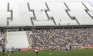 Photo - Corinthians's and Figueirense battle it out during a Brazilian soccer league match at the Itaquerao, the still unfinished stadium that will host the World Cup opener match between Brazil and Croatia on June 12, in Sao Paulo, Brazil, Sunday, May 18, 2014. Only 40,000 tickets were put on sale for Corinthians' match against Figueirense because some of the 20,000 temporary seats needed for the World Cup opener are still being installed. (AP Photo/Andre Penner)