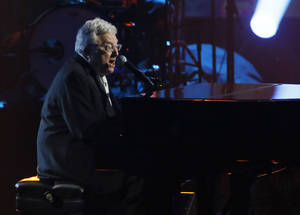 Photo - Randy Newman performs while being inducted into the Rock and Roll Hall of Fame during the Rock and Roll Hall of Fame Induction Ceremony at the Nokia Theatre on Thursday, April 18, 2013 in Los Angeles. (Photo by Danny Moloshok/Invision/AP)