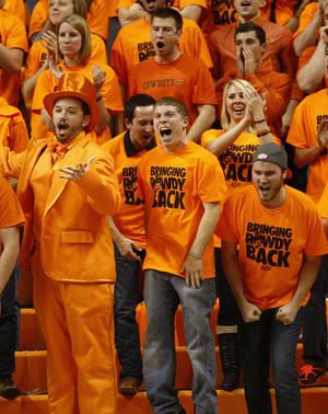 photo - OSU fans cheer during a men's college basketball game between Oklahoma State University (OSU) and Gonzaga at Gallagher-Iba Arena in Stillwater, Okla., Monday, Dec. 31, 2012. Photo by Nate Billings, The Oklahoman
