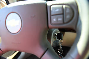 Photo -   A key in the ignition switch of a 2005 Chevrolet Cobalt in Alexandria, Va.  AP Photo  <strong>Molly Riley -  AP </strong>