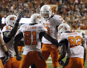 Photo - Oklahoma State's Brandon Weeden (3) celebrates a touchdown pass with Oklahoma State's Justin Blackmon (81) during the college football game between the Oklahoma State University Cowboys (OSU) and the University of Texas Longhorns (UT) at Darrell K Royal-Texas Memorial Stadium in Austin, Texas, Saturday, November 13, 2010. Photo by Sarah Phipps, The Oklahoman